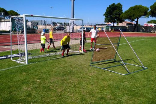 Goalkeeper training with elastic net at AC Milan Soccer Camp