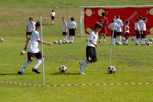 Boys and girls improve their dribbling skills at AC Milan Football Camp