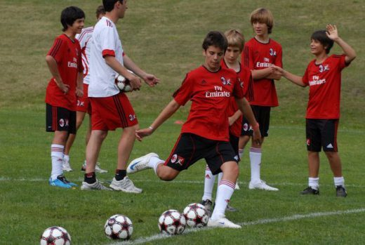 Football shooting training for boys during the AC Milan Academy camp