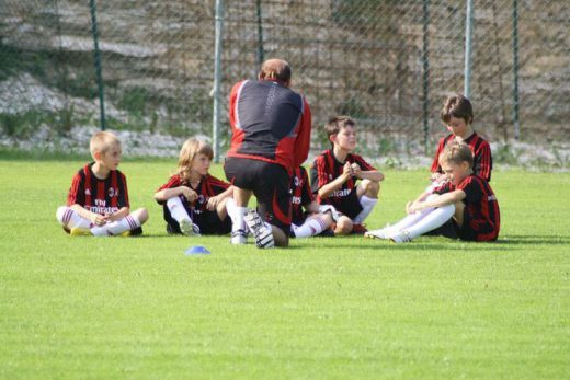 AC Milan Youth Sector coach teaches football to children