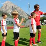 During the training at the AC Milan Academy Camp, the AC Milan supervisor, Stefano Eranio, gives his directions to four children