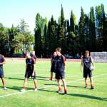 The Sporteventi technical staff on the football field during the AC Milan Acdemy Junior Camp