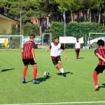 Seven youth during a soccer action at the AC Milan Academy Junior Camp