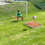 During training at the AC Milan Academy Camp, the goalkeeper performs an exercise with an elastic net to improve reflexes and agility