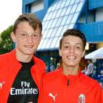 Two boys of the AC Milan Academy Junior Camp in front of the Bella Italia Village in Lignano Sabbiadoro