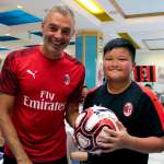 Diego Bortoluzzi, AC Milan supervisor, in the dining room of the AC Milan Academy Camp tourist village in Lignano Sabbiadoro, give a ball to a japanese boy