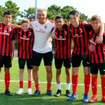 The coach Diego Bortoluzzi with the youth of the AC Milan Academy Camp at the football field of the Bella Italia tourist village in Lignano Sabbiadoro