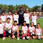 Diego Bortoluzzi with the children of the AC Milan Academy Camp at the playing field of the tourist village in Lignano Sabbiadoro