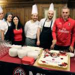 Diego Bortoluzzi cuts the cake with the AC Milan logo prepared by seven chefs of the hotel in Cortina