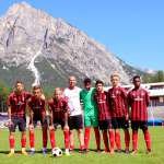 Young players of AC Milan Academy Camp at the playing field of the Cortina d'Ampezzo sports center in the Dolomites