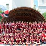 The children of the Milan Academy Camp in front of the Conchiglia in Dibona Square (ex Venezia Square) in Cortina d'Ampezzo
