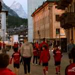 The kids pass along Corso Italia in Cortina d'Ampezzo accompanied by the staff of the AC Milan Academy Junior Camp