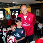 Walter De Vecchi in the dining room of the hotel in Cortina d'Ampezzo with a child and other kids of the AC Milan Academy Camp