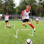 Children during jumping obstacles exercises at the AC Milan Academy Camp in Lignano Sabbiadoro