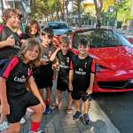 Six children of the AC Milan Academy Camp in front of a Ferrari in Jesolo Lido (Venice)