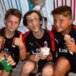 Five children of the AC Milan Academy Camp eat ice cream in Lignano Sabbiadoro