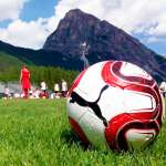 Puma ball on the turf of the playing field of AC Milan Academy Camp in Cortina d'Ampezzo