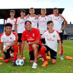 The coach Pierino Prati with seven youth of the AC Milan Academy Junior Camp at the Jesolo stadium (Venice)