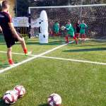 A coach of Sporteventi's staff during AC Milan Academy Camp in Lignano Sabbiadoro, kick the ball so that the young goalkeeper can improve in the catch
