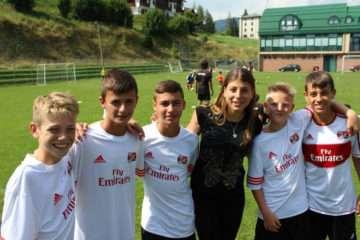 Sporteventi female staff with children at AC Milan Camp