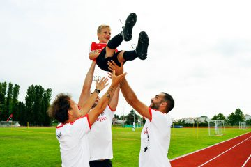 Happy children with Sporteventi staff at AC Milan Academy Camp