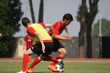 Two young talents in a soccer action at AC Milan Camp